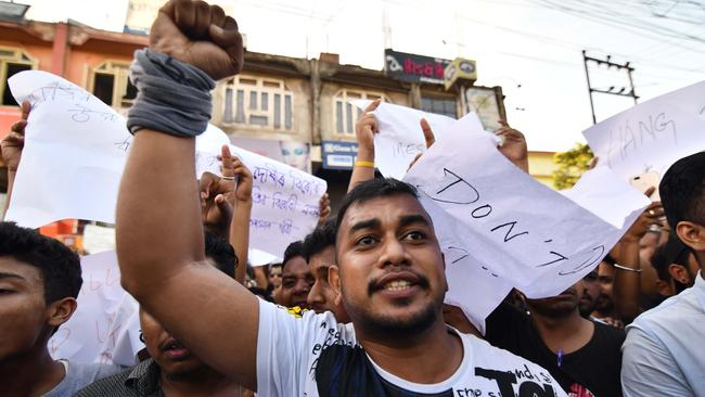 A student shouts slogan during a protest march demanding to arrest and punish the culprits involved in the killing of Abhijeet Nath and Nilotpal Das in Karbi Anglong district of Assam, in Guwahati on June 10, 2018. Picture: AFP/Biju Boro