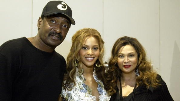 Beyonce, centre, with her father Mathew Knowles and her mother Tina Knowles in 2005. Picture: House of Dereon via Getty Images