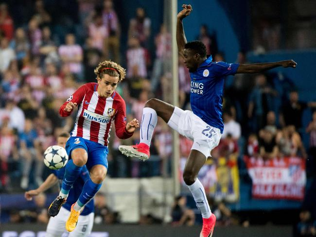 Atletico Madrid's French forward Antoine Griezmann vies with Leicester City's Nigerian midfielder Wilfred Ndidi.