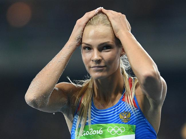 Long jumper Darya Klishina was the only Russian allowed to compete in athletics in Rio because she'd lived in the US for the three years prior. / AFP PHOTO / Johannes EISELE