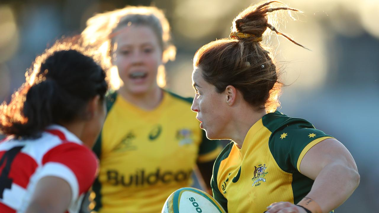 Lori Cramer of the Wallaroos runs the ball at Newcastle Sportsground.
