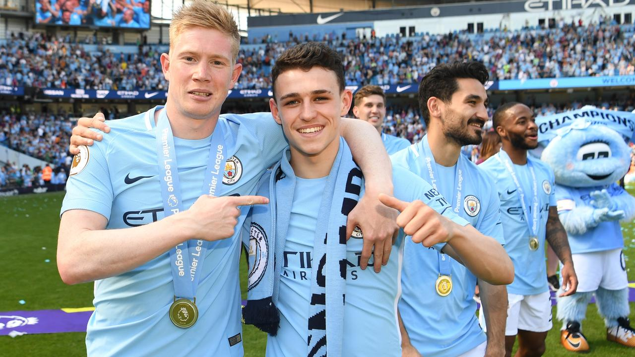 Kevin De Bruyne and Phil Foden of Manchester City celebrate winning the Premier League.