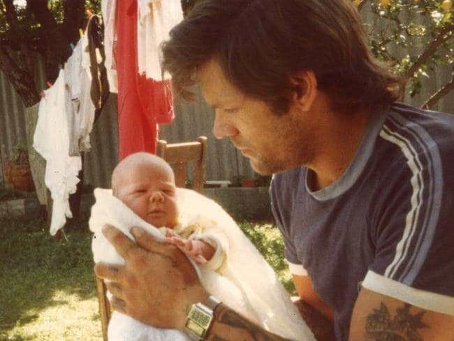 Allan holds his daughter Nina, pictured in Fremantle in 1984.