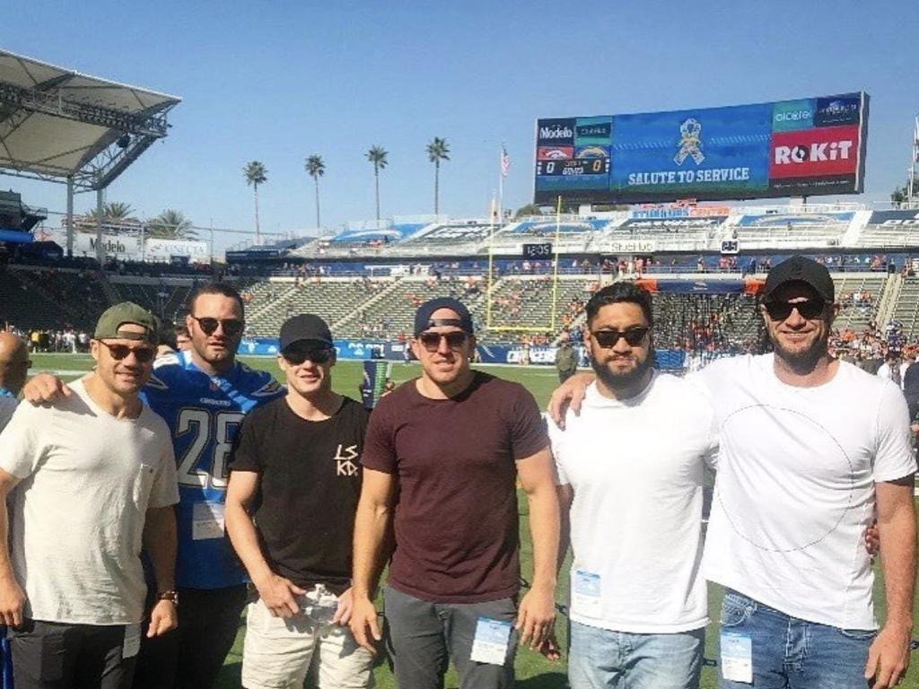The Roosters at an NFL game during last year's trip.