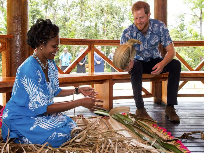The Duke of Sussex watches a demonstration of traditional mat weaving as he attends a dedication of the Colo-i-Suva forest to the Queen's Commonwealth Canopy in Suva.