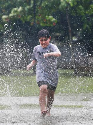 Reuben Kyriacou, 8, makes the most of wet weather in Cairns as a result of ex-Tropical Cyclone Owen. Picture: Brendan Radke