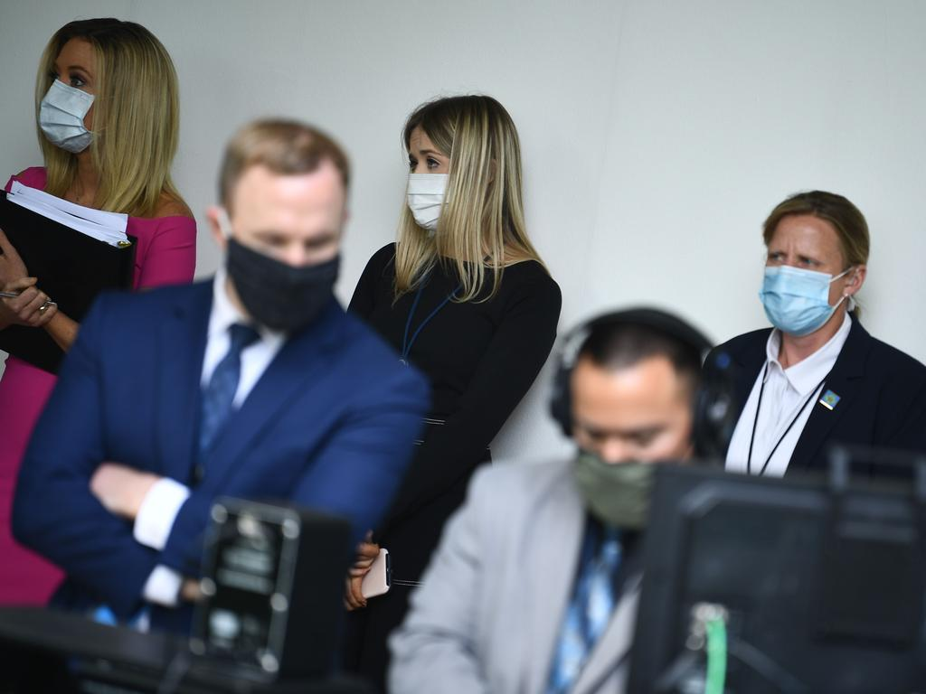 White House Press Secretary Kayleigh McEnany (L) looks on with other White House staff as US President Donald Trump speaks during a press conference. Picture: AFP