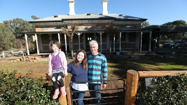 Vendors Nicola and Matthew Carlile with their daughter Rose at their now former home. PIC TAIT SCHMAAL.
