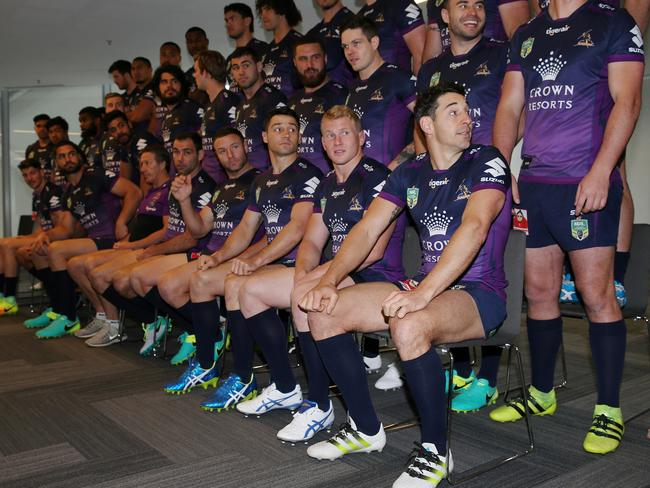 Billy Slater sits injured in the 2016 grand final team photo. Picture: Colleen Petch.