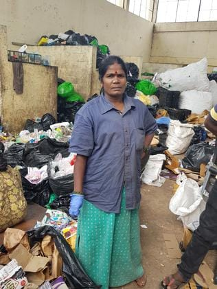 Rani, 48, sorts waste in a stinking room.