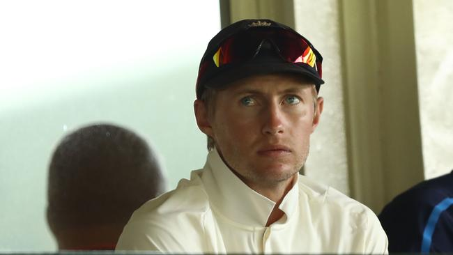 Joe Root of England looks on from the changerooms after leaving hospital.
