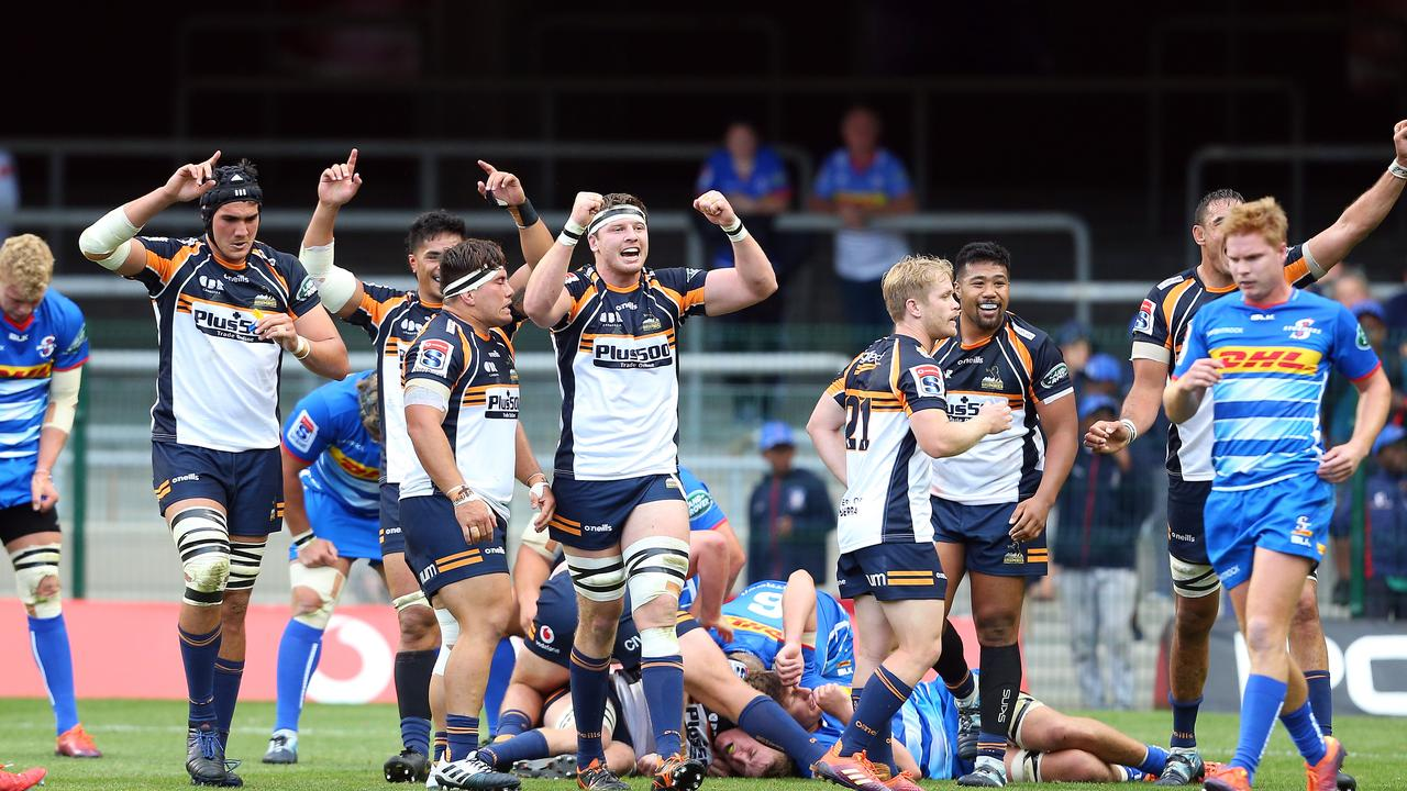 The Brumbies celebrate their win against the Stormers at Newlands.