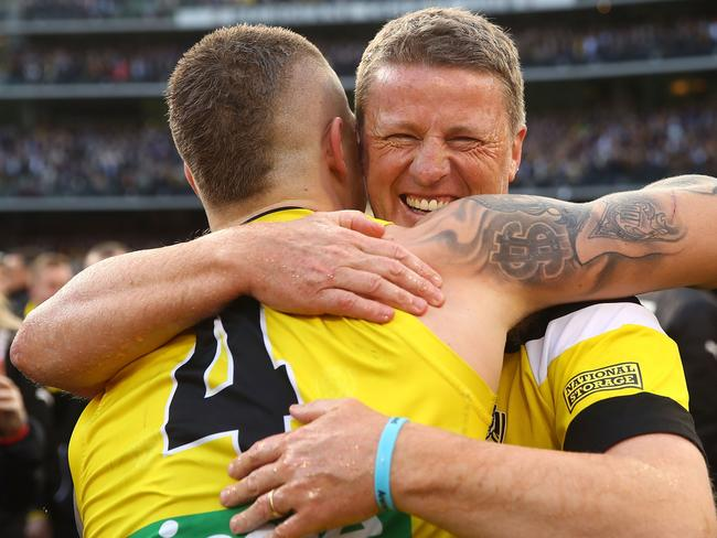 Damien Hardwick (R) hugs Dustin Martin. (Photo by Mark Kolbe/AFL Media/Getty Images)