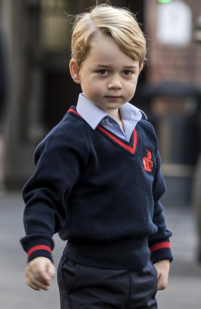 The world watches every one of his milestones, like his first day of kindergarten at Thomas's school in Battersea. Picture: Richard Pohle/AFP