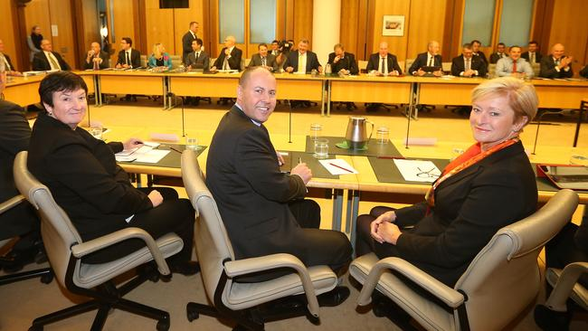 Business Council of Australia chief executive Jennifer Westacott (left) with Minister for the Environment and Energy Josh Frydenberg, Chair of the Minerals Council of Australia, Vanessa Guthrie at the meeting with coalition backbenchers last night. Picture: Kym Smith