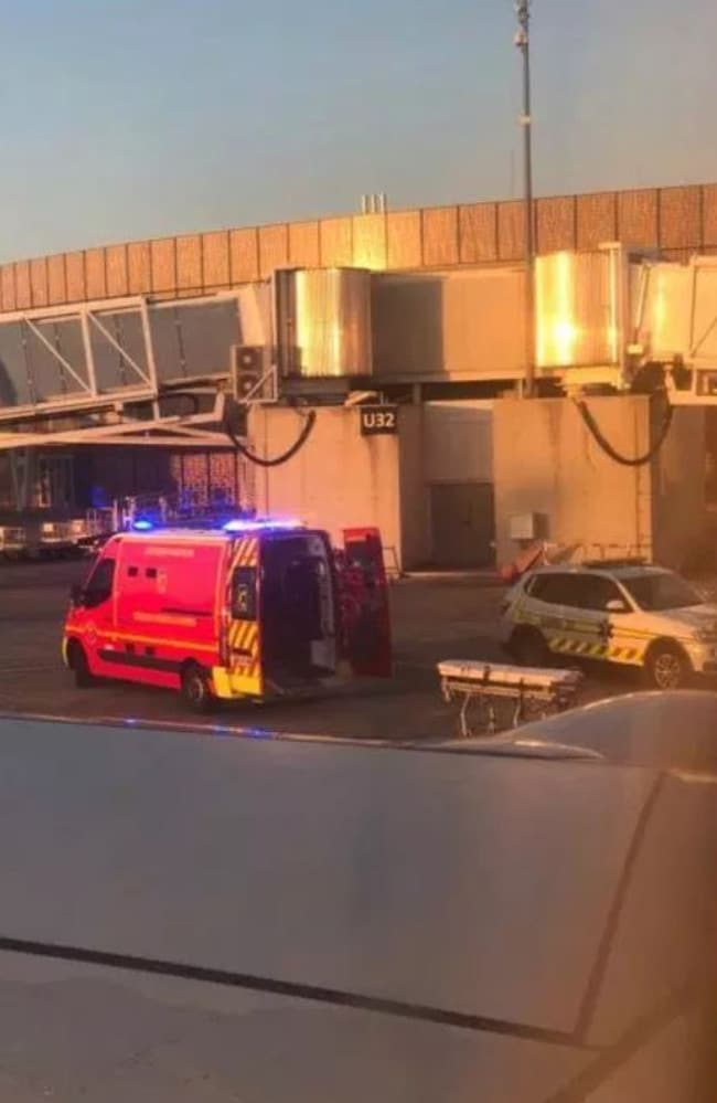 An ambulance waits for a British man at an airport in Toulouse, France, after he suffered a medical emergency on a flight to Ibiza.