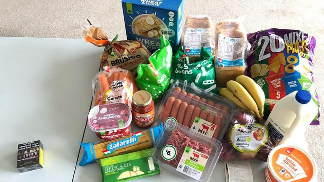She bought a popular brand of cigarettes, which cost $56.95, to teach her grandkids about what you can buy in food with the same amount of money. Picture: Facebook/ JudyKerrison
