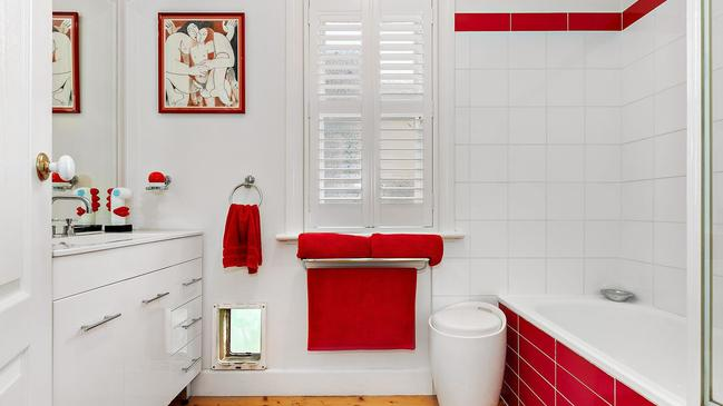 Quirky red and white flair in the bathroom.