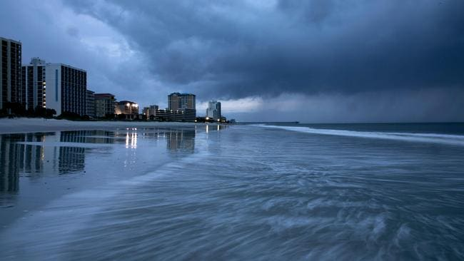Rain begins to fall as the outer bands of Hurricane Florence make landfall in Myrtle Beach, South Carolina on September 13, 2018. Picture: Alex Edelman/AFP