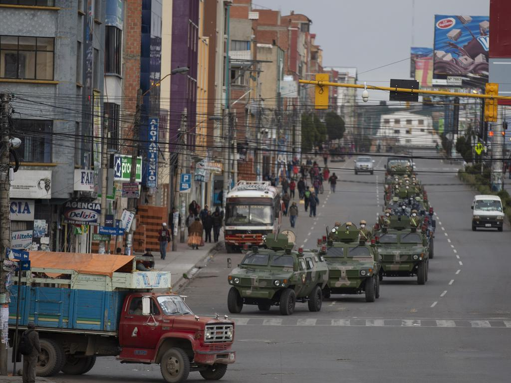 Military armored vehicles patrol the streets during a quarantine in El Alto, Bolivia. Image: AP