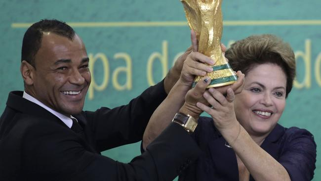 Former Brazilian soccer player Cafu and Brazil's President Dilma Rousseff with the 2014 World Cup trophy. Picture: Eraldo Peres