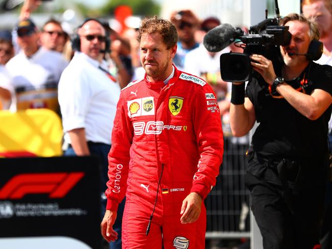 Sebastian Vettel walks in to parc ferme to swap the 1st and 2nd place boards. Picture: Dan Istitene/Getty Images
