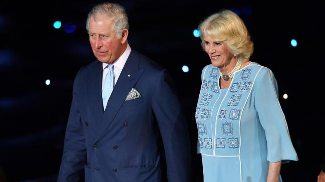 Prince Charles with Camilla, who will never truly be seen as a queen. Picture: Darren England