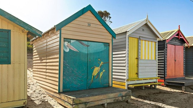 Bathing Box 34 on Brighton's Dendy Beach comes with a bright mural on its facade.