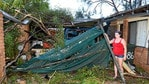 Shania Cameron at her grandparents' house, assessing the damage after a fallen tree crushed her grandparents' car. Picture: Alistair Brightman
