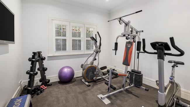 A gym is part of the house's current set-up.