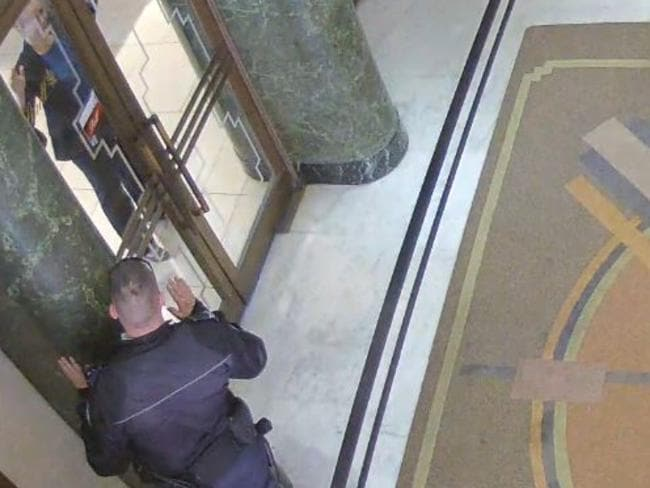 CCTV footage shows Senior Constable Paul Withers interact with Katrina Dawson at the Lindt Cafe in Martin Place. Constable Withers was the first responded on the morning of the siege.
