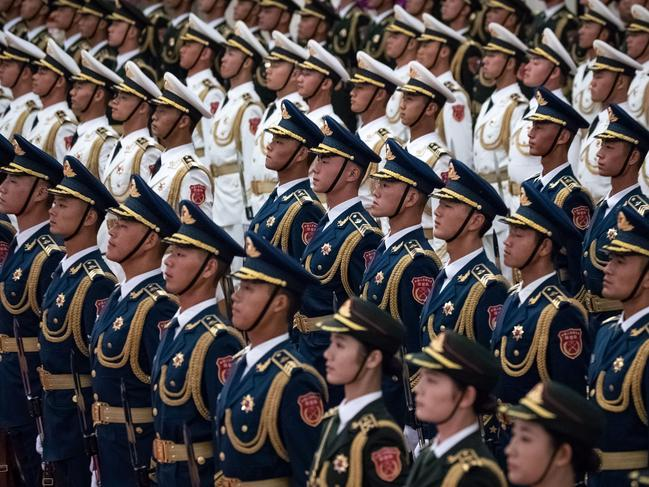 Chinese People's Liberation Army honour guard at the Great Hall of the People in Beijing. Chinese state-run media has ramped up calls to be prepared for war. Picture: AP