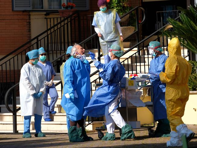 Medical personnel at a retirement home in Rome undergo coronavirus tests after the death of a patient. Picture: AP