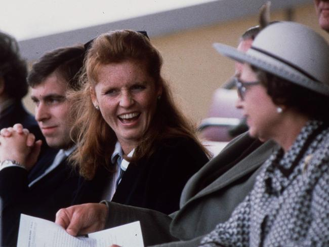 Sarah Ferguson, Duchess of York and husband Andrew, Duke of York with his mother Queen Elizabeth II in 1986. Picture: Supplied