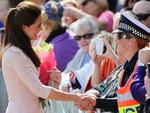 Catherine, Duchess of Cambridge, greets a police officer at Playford Civic Centre in Elizabeth, South Australia. Picture: Daniel Kalisz/Getty Images