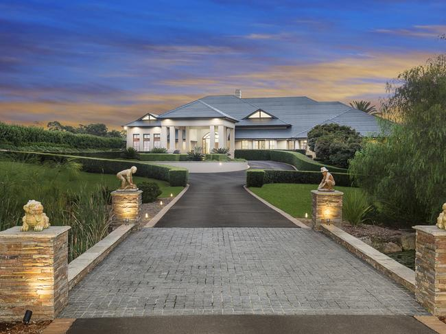 The home is positioned on magnificent landscaped grounds