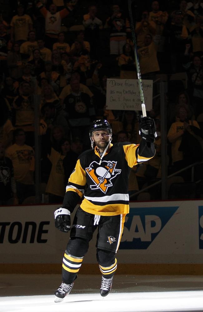 Bryan Rust #17 of the Pittsburgh Penguins acknowledges the fans after defeating the New York Rangers.