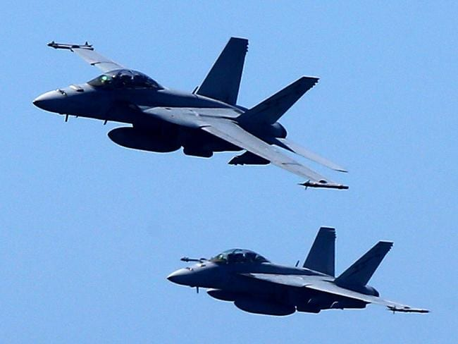 Two US Navy F/A-18F Super Hornets were directed to intercept an unexplained radar contact made by a US cruiser off California. What they saw 'weireded them out'. Picture Mike Batterham