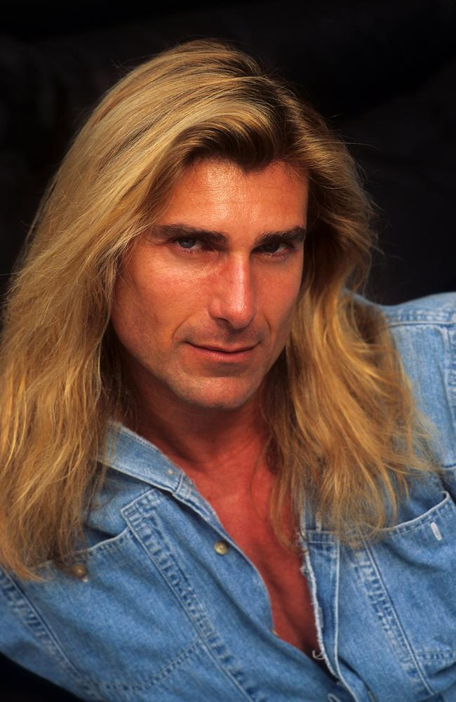 How can you not remember those luscious, long locks. Here he is posing for a portrait in 1996 in LA. Picture: Donaldson Collection