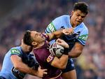 Billy Slater (centre) of the Maroons is tackled by Boyd Cordner (left) and Latrell Mitchell (right) of the Blues during Game 3 of the 2018 State of Origin series between the NSW Blues and the Queensland Maroons at Suncorp Stadium in Brisbane, Wednesday, July 11, 2018. (AAP Image/Darren England)