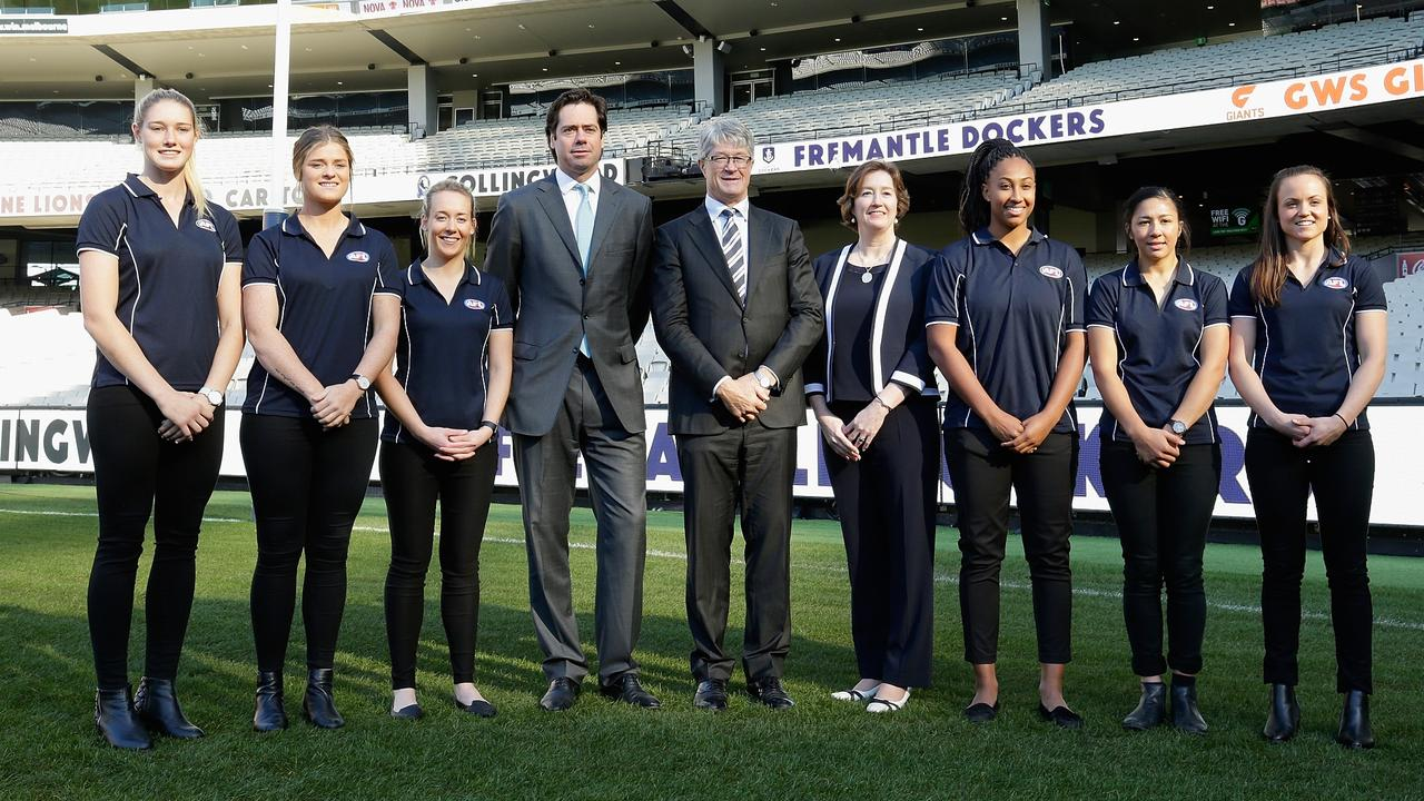 Gillon McLachlan, Chief Executive Officer of the AFL, with marquee AFLW players.