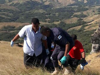 Police drag bodies of the five victims from where they were found at a lookout in Fiji's rugged Nausori Highlands. Picture: Supplied