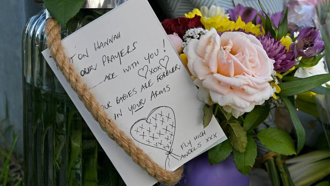 Flowers and cards left at the scene. Picture: John Gass/AAP
