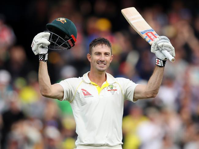 Shaun Marsh celebrates after reaching his century.