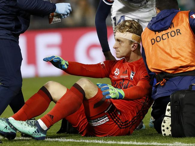 Melbourne Victory's Lawrence Thomas is attended to by team doctors. Picture: Toby Zerna