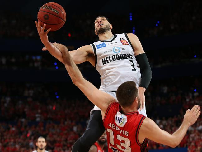Josh Boone of United fouls Tom Jervis of the Wildcats. Picture: Paul Kane/Getty Images