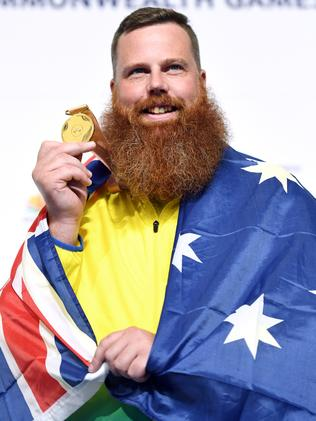 Daniel Repacholi accepts his Commonwealth Games gold medal.