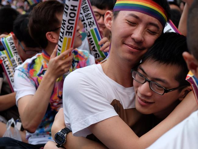 Same-sex activists hug outside the parliament in Taipei. Picture: AFP