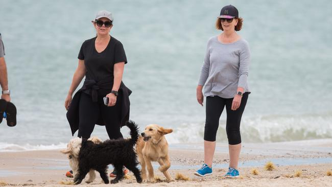 Julia Gillard, right, on Brighton beach this week with a friend. Picture: Mega