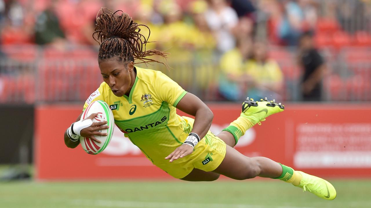 Australia's Ellia Green dives to score a try against Spain in Sydney.